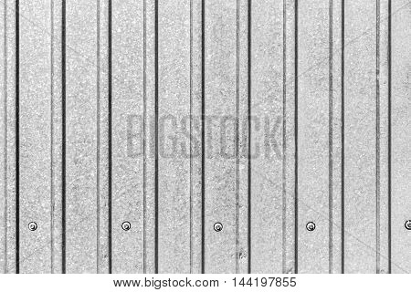 Part of the surface of the profiled sheet of galvanized steel as the background.