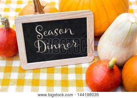 Different Sorts Of Pumpkins And Slate With Text Season Dinner