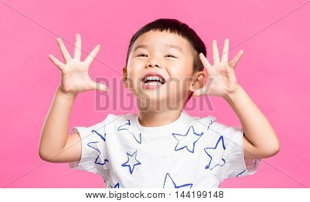 Excited little boy showing grimace