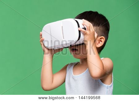 Asian boy looking though VR device