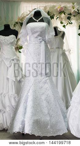 traditional special wedding dresses in bridal salon
