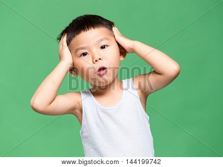 Little boy touch on his head
