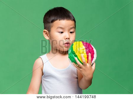 Asian boy play with paper ball
