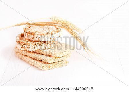 Dietary a low caloric grain crackers on a white background