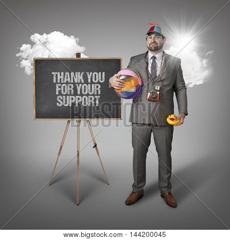 Thank you for your support text with holiday gear businessman and blackboard with text