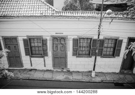 Rio De Janeiro RJ Brazil - March 07 2016: Picturesque houses along the famous neighborhood of Santa Teresa Rio de Janeiro Brazil.