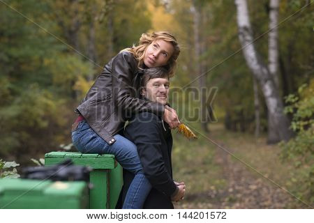 Loving couple kissing in the autumn forest