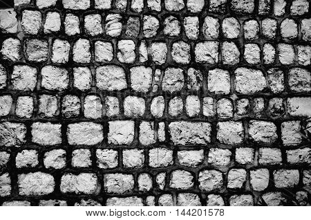 Historic stone walls decorated with cement and paint. Background-Texture