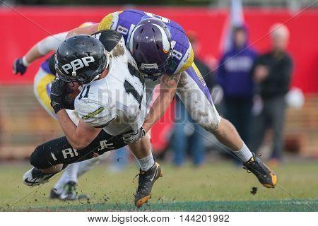 VIENNA, AUSTRIA - JUNE 20, 2015: DB Stefan Ruthofer (#8 Vikings) sacks QB Jan Dundacek (#11 Panthers) in a game of the Austrian Football League.