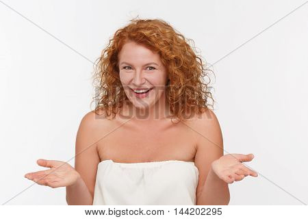 Portrait of cunning mature of middle aged woman inwhite dress posing isolated on white. Red haired lady showing different emotions.