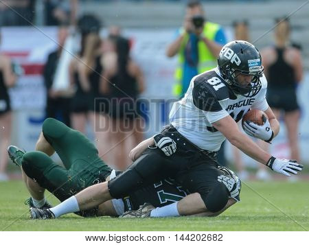 VIENNA, AUSTRIA - MAY 16, 2015: CB Ivan Kozlov (#27 Dragons) tackles WR Martin � indler (#81 Panthers) in a game of the Austrian Football League.