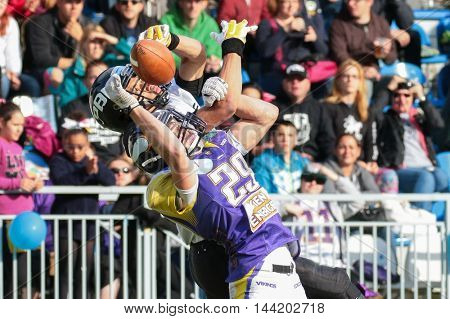 VIENNA, AUSTRIA - JUNE 20, 2015: DB Andreas Lunzer (#29 Vikings) tackles WR Jakub Wolesky (#2 Panthers)  in a game of the Austrian Football League.