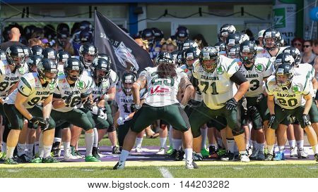 VIENNA, AUSTRIA - JULY 5, 2015: LB Ramon Azim (#25 Dragons) cheers his team up before a game of the Austrian Football League.