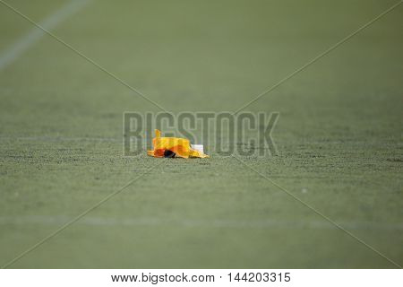 MOEDLING, AUSTRIA - MAY 24, 2015: A penalty marker lies on the field in a game of the Division I of the Austrian Football League.