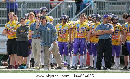 VIENNA, AUSTRIA - MAY 10, 2015: Head Coach Thomas Oelboeck instructs his team in a game of the Division I of the Austrian Football League.