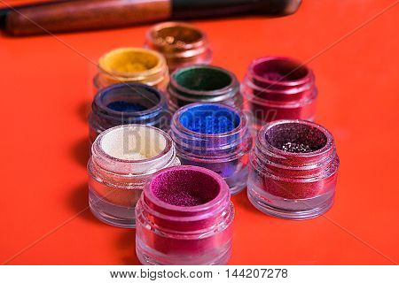 Various makeup products on the colotful background