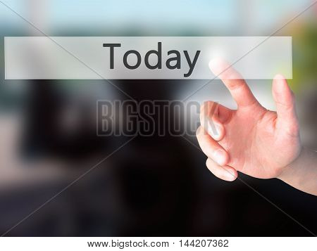 Today - Hand Pressing A Button On Blurred Background Concept On Visual Screen.