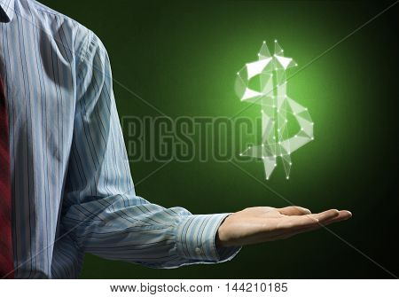 Close up of businessman showing glowing dollar sign in palm