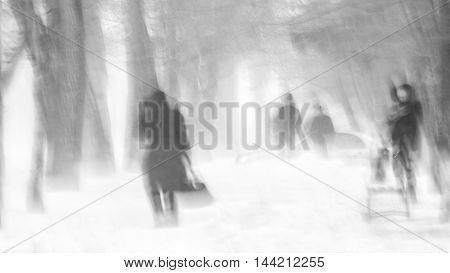 People on the street in winter. Strong storm, blizzard, cold. Black and white photo of an extreme snowy windy winter.