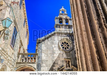 Old stone Saint Mihovil's church in city center of town Korcula, Croatia, architecture details.