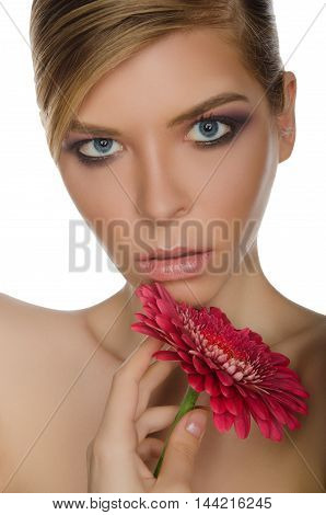 young woman with red chrysanthemum isolated on white