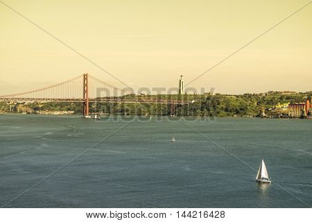 Tagus river and 25th April bridge in Lisbon Portugal