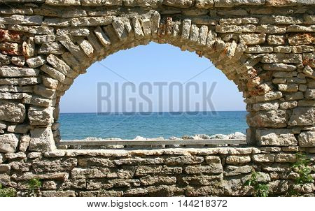 stone window overlooking the sea and the sky