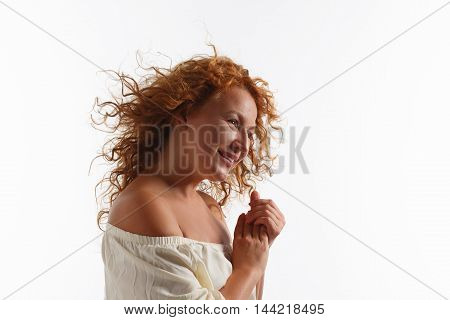 Portrait of beautiful middle aged woman with running hair in studio. Pretty mature or senior lady happy smiling isolted on white background.