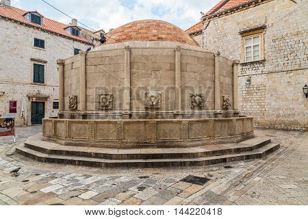 DUBROVNIK CROATIA - 11TH AUGUST 2016: A view of Onofrio's Big Fountain at Poljana Paskoja in Dubrovnik Old Town during the day