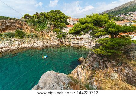 DUBROVNIK CROATIA - 11TH AUGUST 2016: Beaches and Coves in Dubrovnik during the summer. People can be seen.