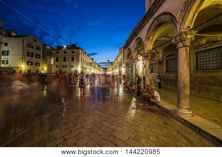 DUBROVNIK CROATIA - 11TH AUGUST 2016: A view along streets of Dubrovnik at night. The blur of people can be seen.