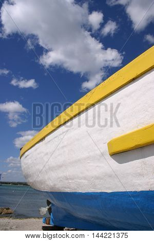 freshly painted fishing boat near the sea