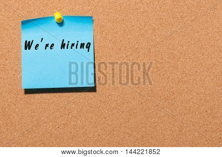 WE'RE HIRING consept on notice board. Human Resources concept