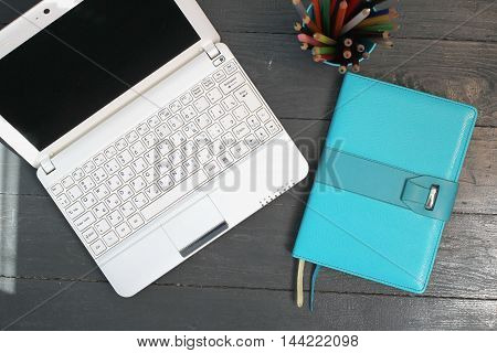Blue Book and laptop on the floor