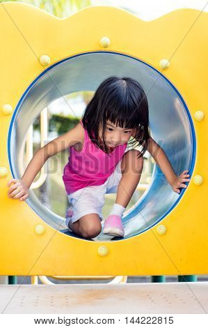 Asian Chinese Little Girl Crawling At Playground