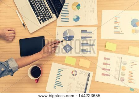 business people analyzing investment charts. Accounting Business concept soft focus vintage tone