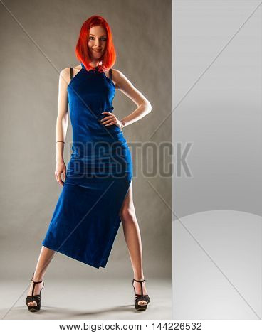 Red-haired Girl In An Evening Dress