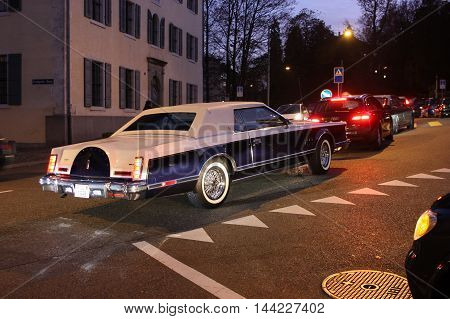 Zurich, Switzerland - November 27, 2011. Retro car Lincoln Mark VI moves around the city, approaching an intersection
