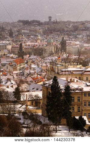 Amazing Towers Of Charles Bridge And Old Town District During Winter Day. Heavy Snow Storm And Sunra