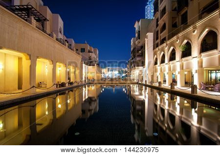 Colorful Reflection Of Souk Building In Downtown Area During Calm Night. Calm Water In Hotel And Res