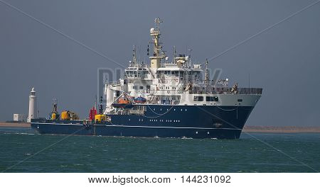 photo of a ship with buoys on deck