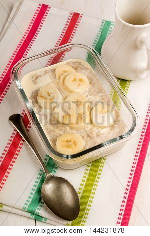 irish steel cut oats cooked with cream and banana slices in a glass bowl
