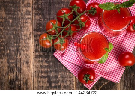 Tomato Juice And Fresh Tomatoes On A Wooden Background
