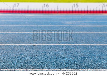 blue track with measuring strip on background
