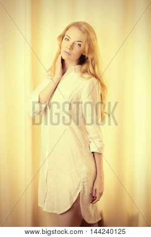 Pretty blonde young woman at home. Natural beauty. Home lifestyle.
