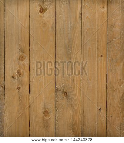 close up of old weathered and textured rough sawn boards on a fence.