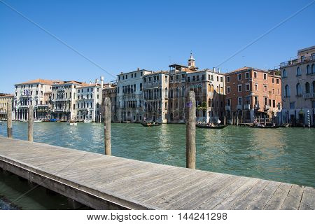 VENICE,ITALY-AUGUST 17,2014:Mooring for gondolas on the Grand Canal of Venice near the Rialto bridge