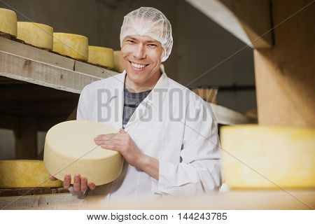 Producing fresh cheese at factory in Russia