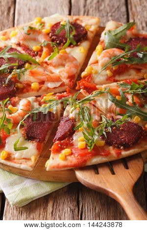 Sliced Pizza With Shrimp, Salami, Cheese And Arugula Close-up. Vertical