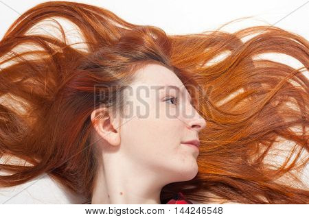 Portrait Of The Girl's Red Hair